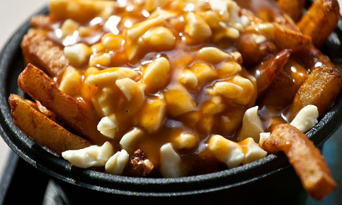 foods to try around the world - poutine