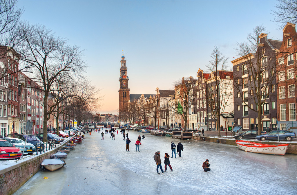 Skaters enjoy the ice on a winter evening on the Prinsengracht in Amsterdam, the Netherlands.