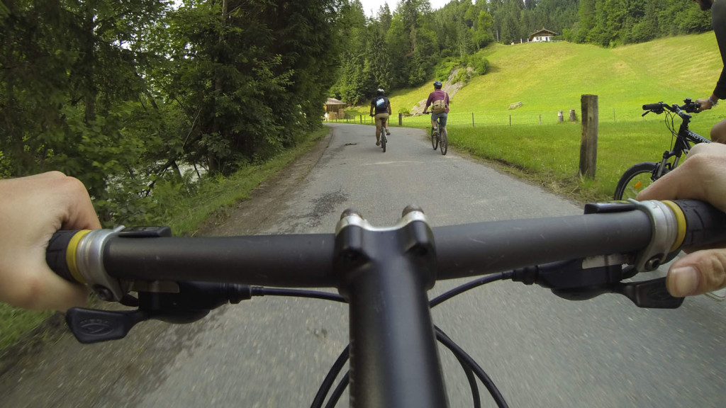 Adventures in Europe - image of handle bars following two cyclists