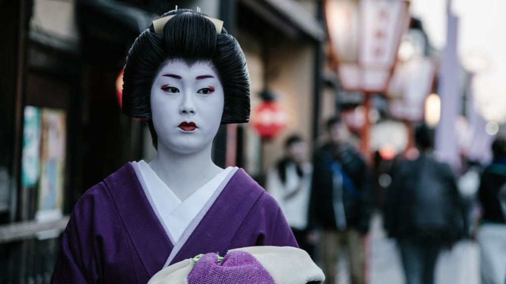 image of a Geisha walking down the street