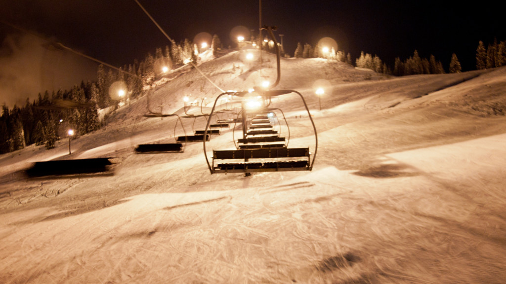 Image of an empty ski lift at night