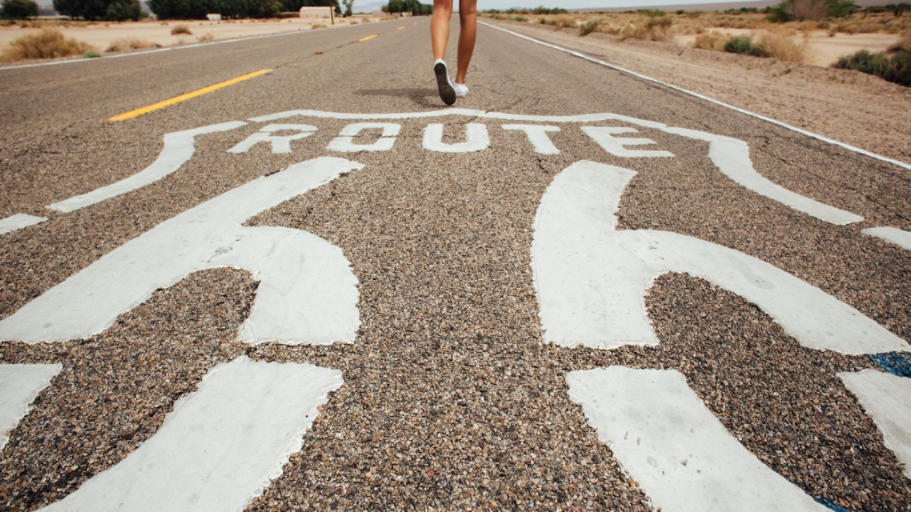 the USA best RoadTrip's - close up shot of feet walking on the Route 66 sign
