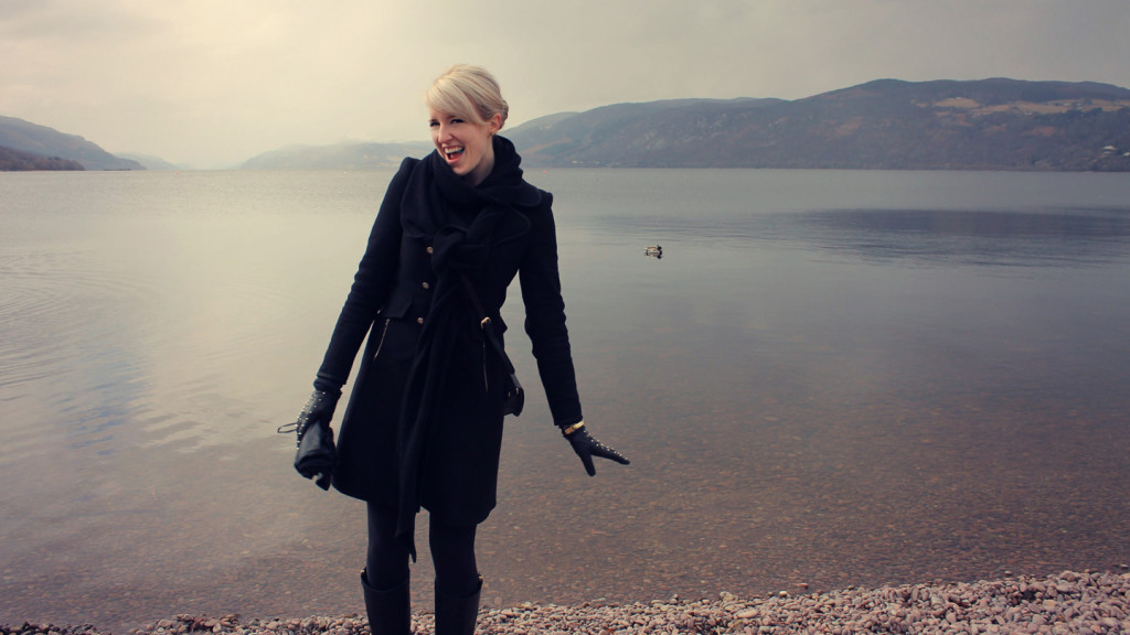 Bonnie Scotland: A Photo Essay - Image of Lauren from This Renegade Love standing on the edge of a Loch