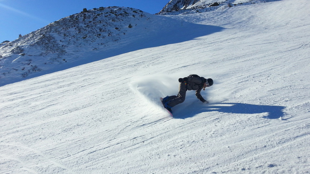 image of a snow boarder on an empty ski run