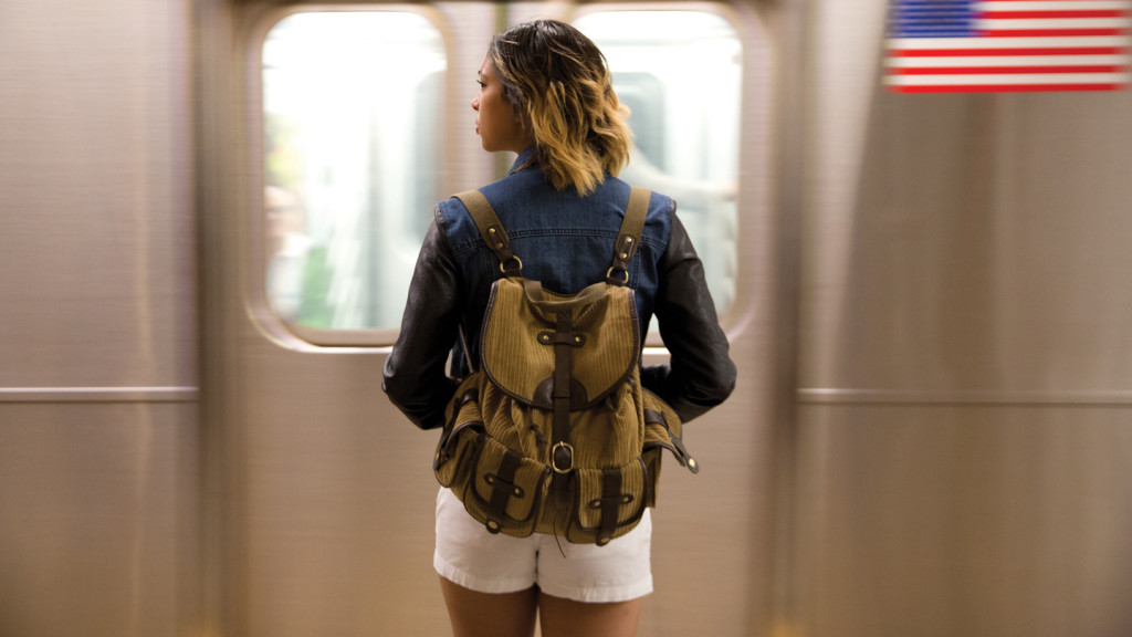 Travel photography tips for beginners - girl standing in New York subway with train passing at speed