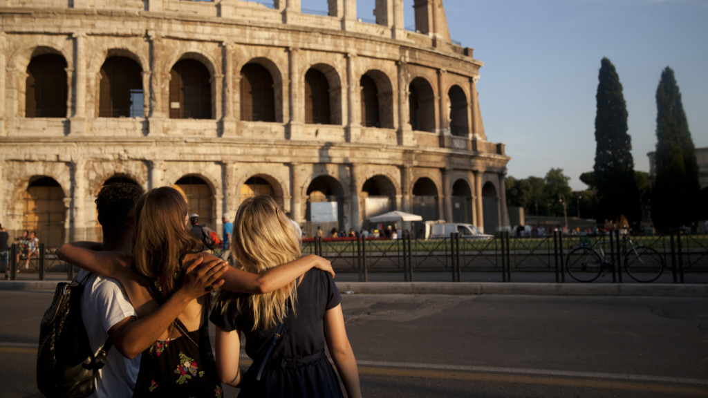Image of three people standing outside the Colosseum