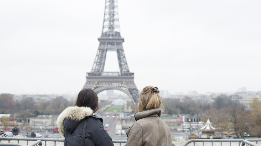 Image of two girls looking at the Eiffel Tower