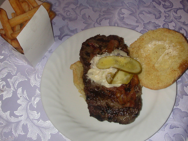Image of a squashed burger on a plate