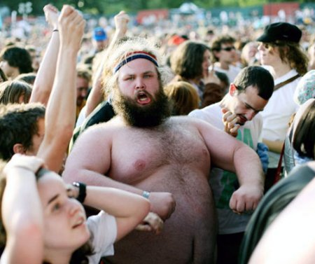 image of a large bare chested man in a crowd