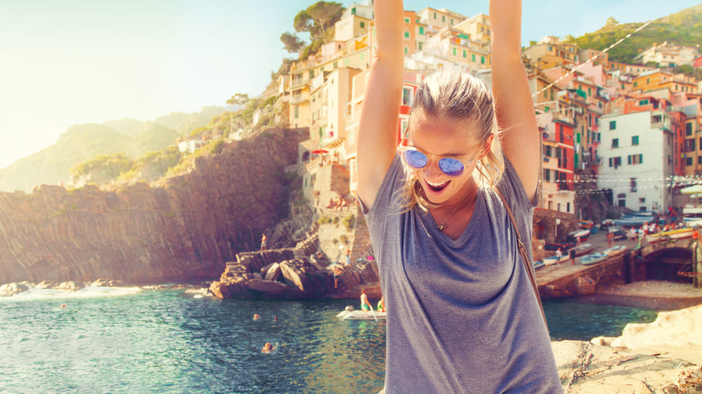 self improvement - image of a girl raising her arms in Cinque Terre
