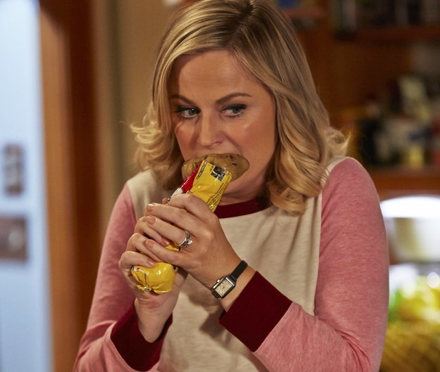 Image of Amy Poehler from Parks and Recreation eating cookie dough