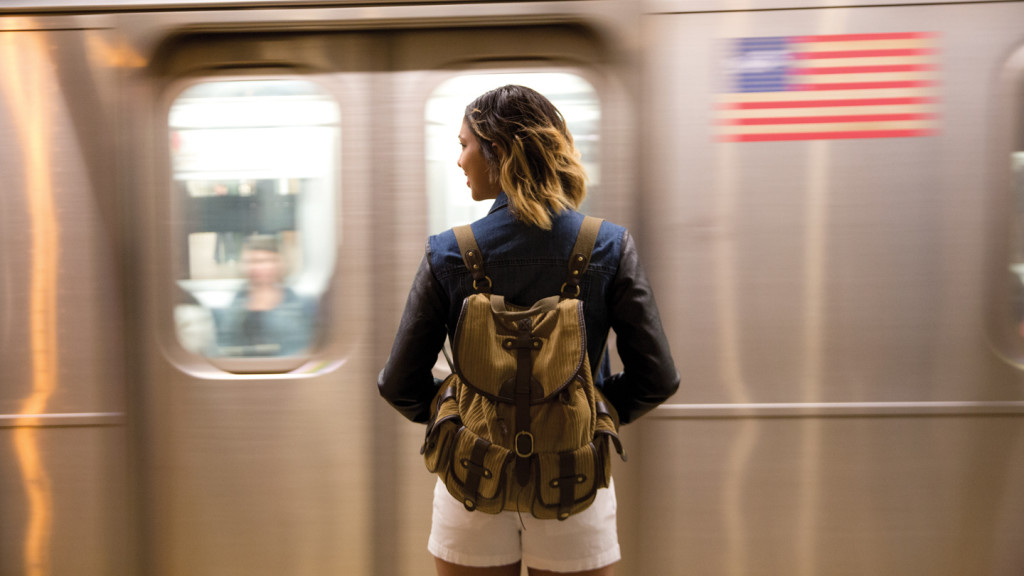 self improvement - image of a girl standing on a subway platform