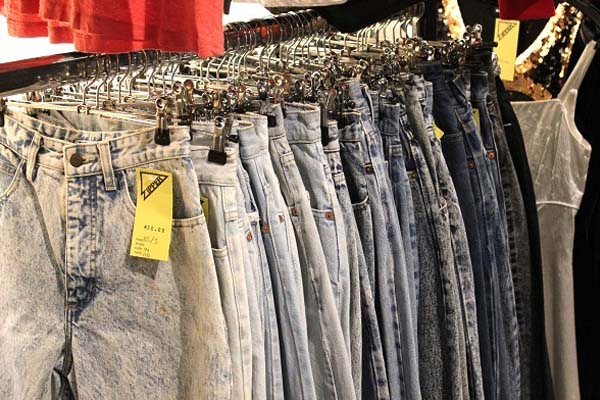 vintage stores in amsterdam - vintage jeans on a rack at Zipper