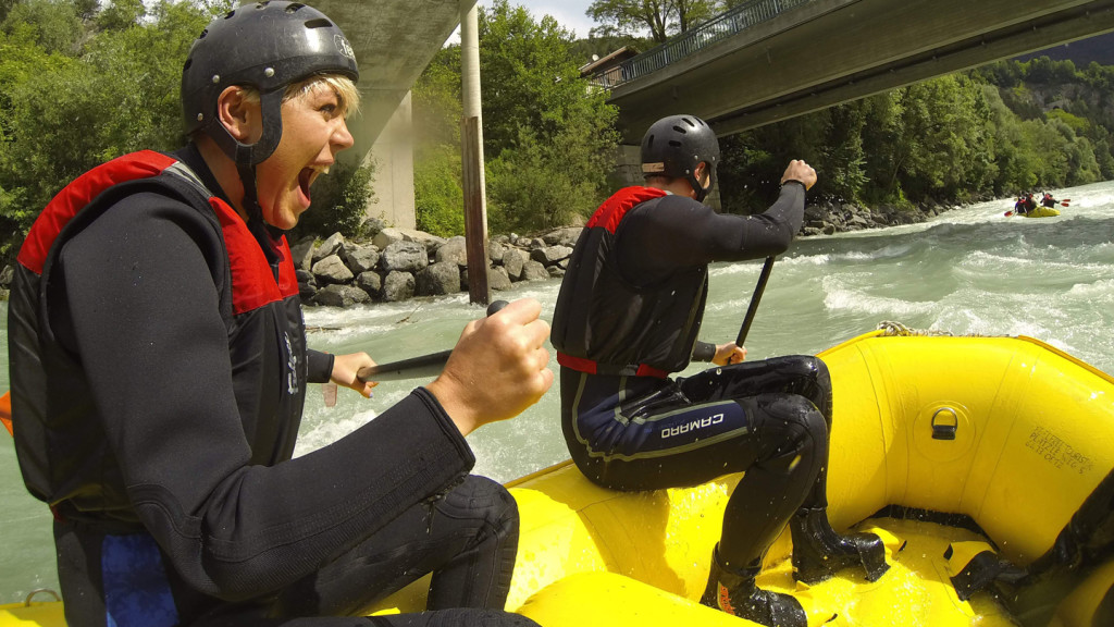 adventure travel - image of a girl white water rafting