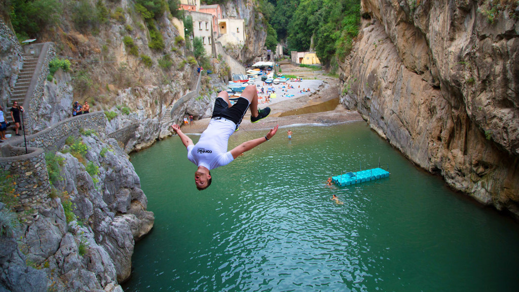 contiki legends - image of a cliff diver jumping backwards