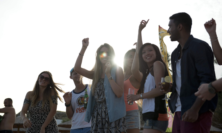 things to do in korcula - image of a group of friends dancing