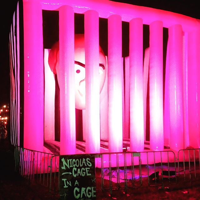 Image of Nicholas cage in a cage at Splendour
