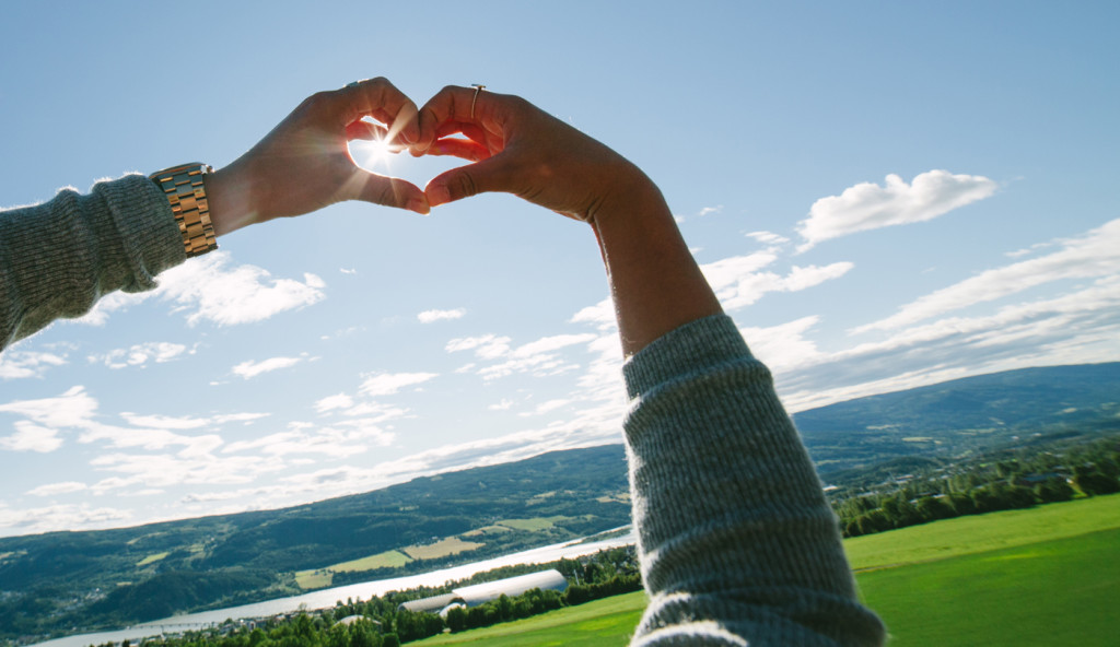 blue monday - hands making a heart shape in the sky