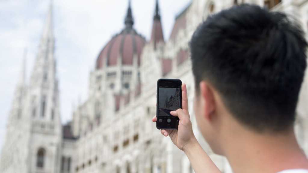 new years resolutions - guy taking a selfie in budapest