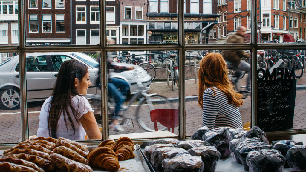 travel photography - girls outside cafe in amsterdam