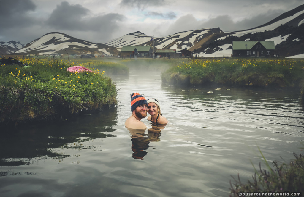 Around the world on a bus - couple in lake in iceland