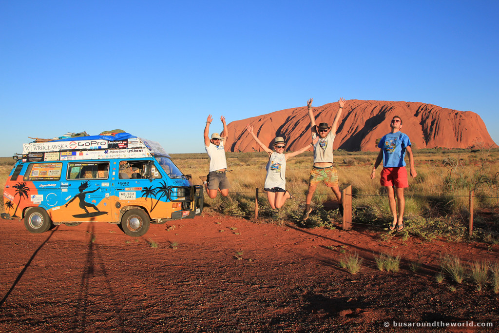 Around the world on a bus - jumping in front of Uluru