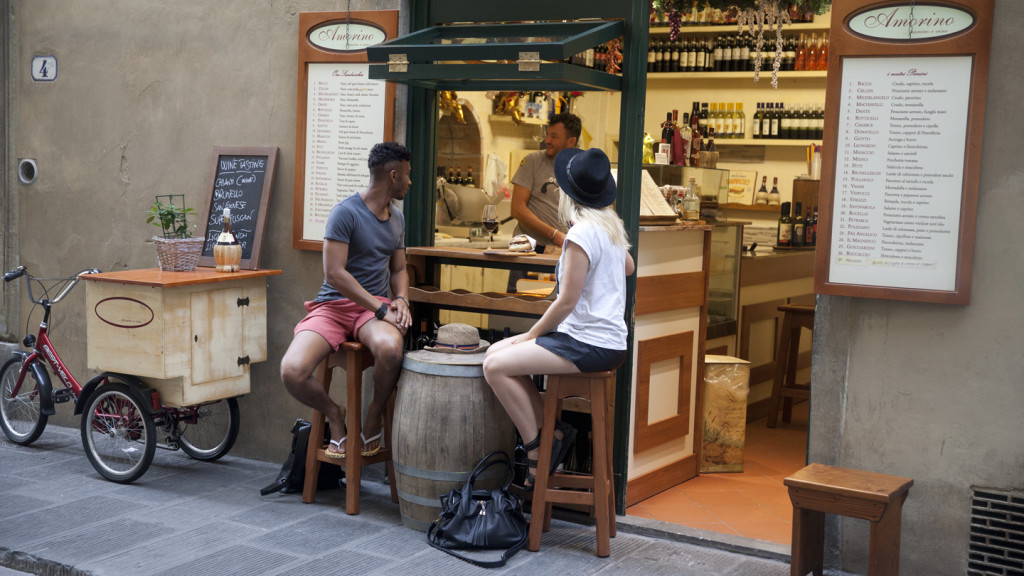 trip to europe - couple chatting to local in cafe