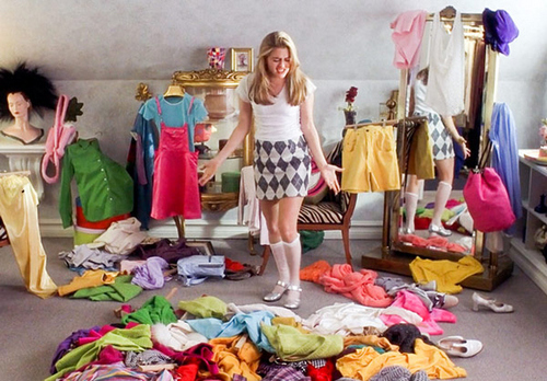 Girl with pile of clothes