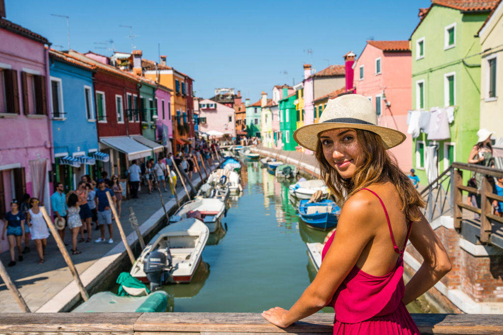 image of girl looking back at camera in Burano - change your life