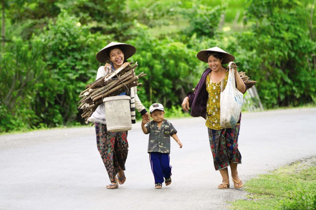 two locals going to work in Luang Prabang