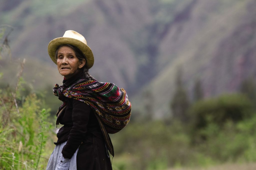 old lady on the road in peru