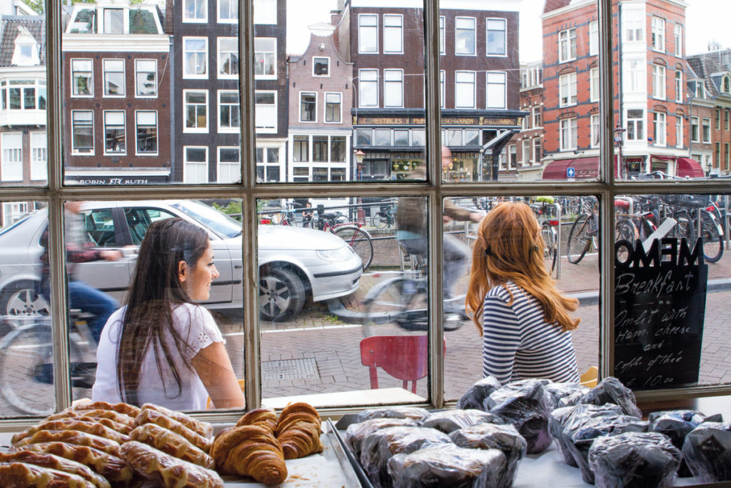 girls sitting outside cafe in amsterdam