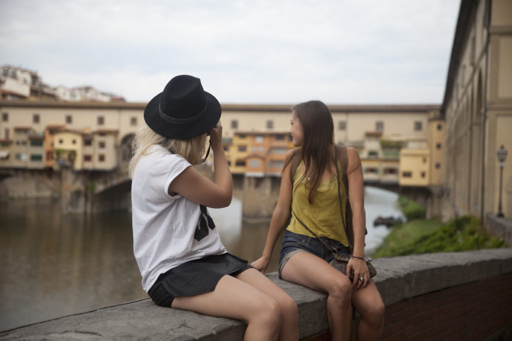 girls looking over the river in florence