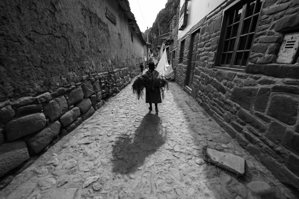 local lady walking down the street in peru
