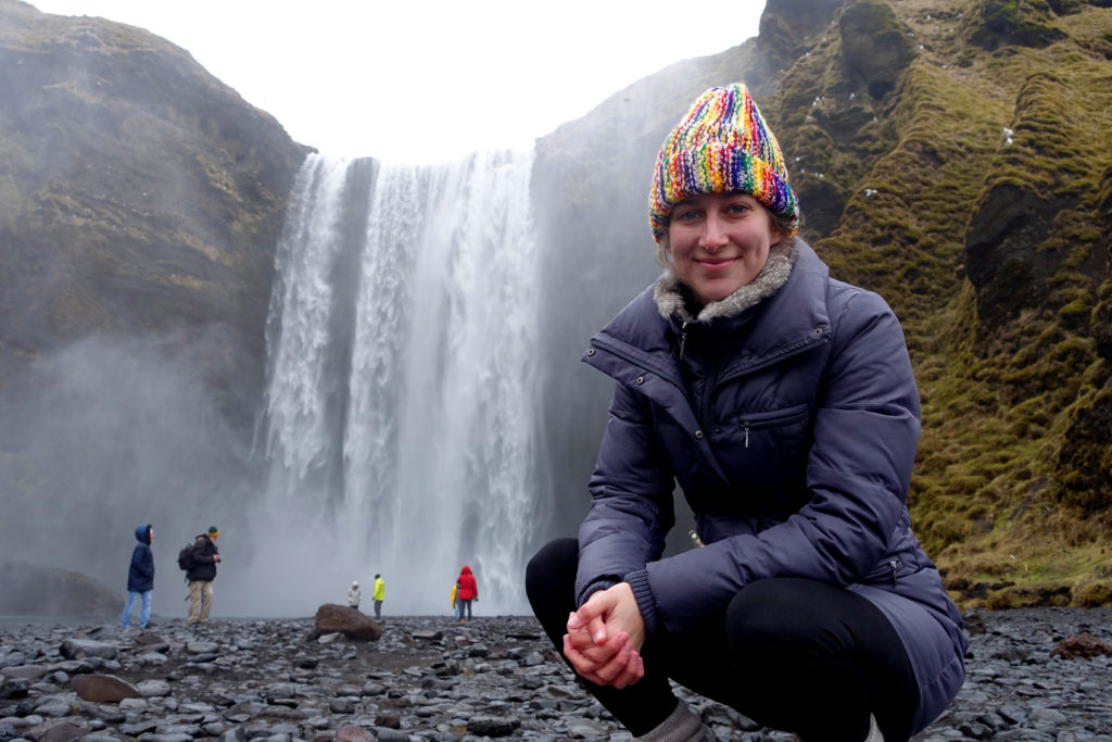 image of alli speed next to a waterfall in iceland