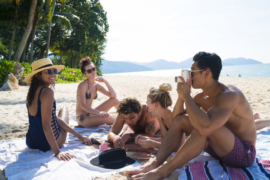 group of travellers on beach