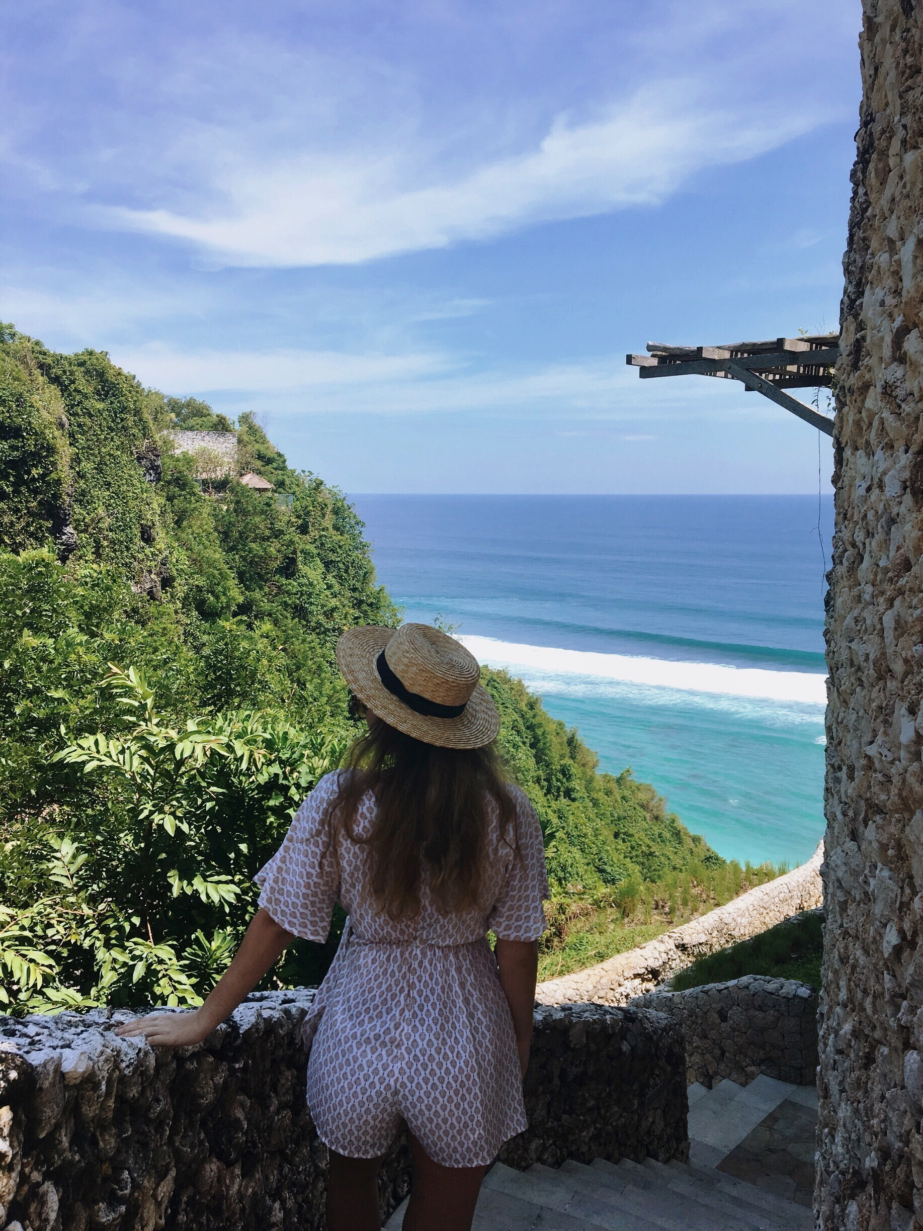 Girl looking out onto sea in Bali