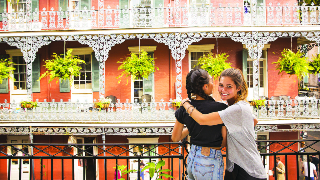 Two Contiki girls in front of some architecture