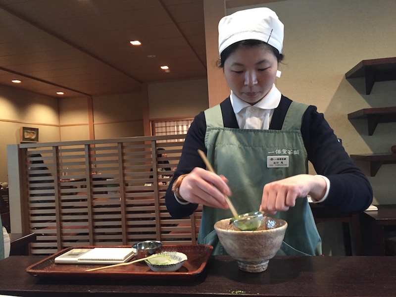 Lady making tea in a kyoto tea house