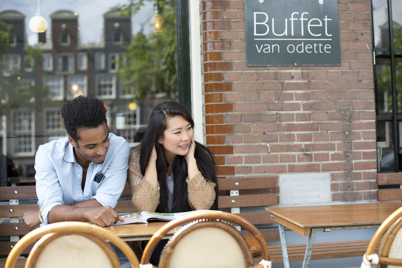 boy and girl outside cafe in Amsterdam