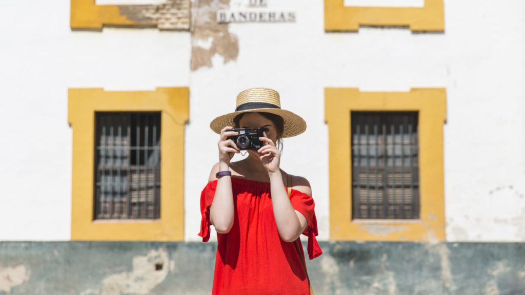 girl taking photo facing camera