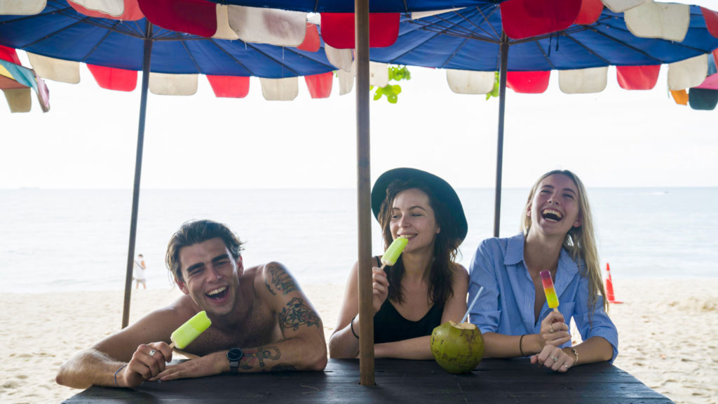 Group laughing on a beach