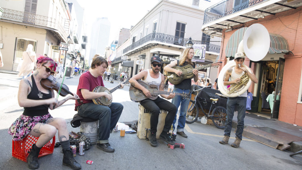group playing music in street