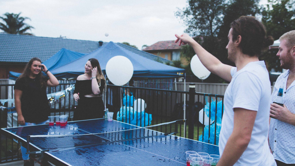 group of friends playing ping pong