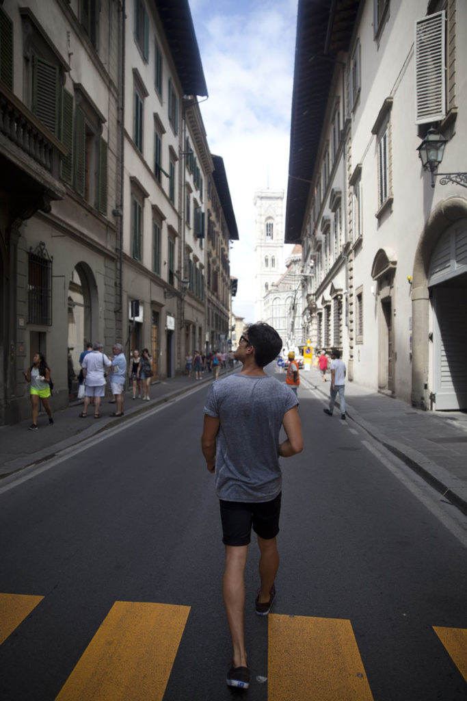 man walking around Florence streets