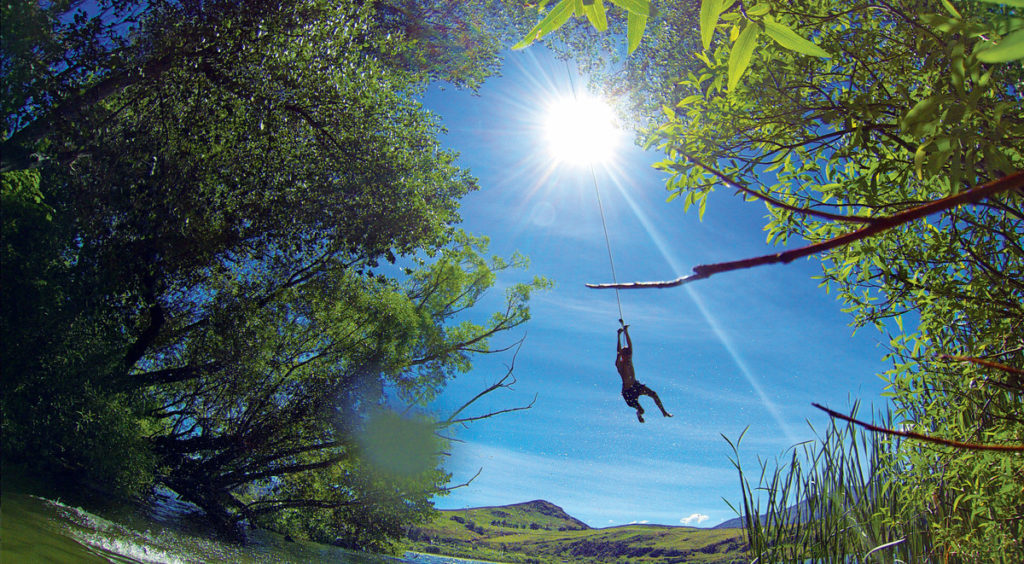 swinging into lake in new zealand