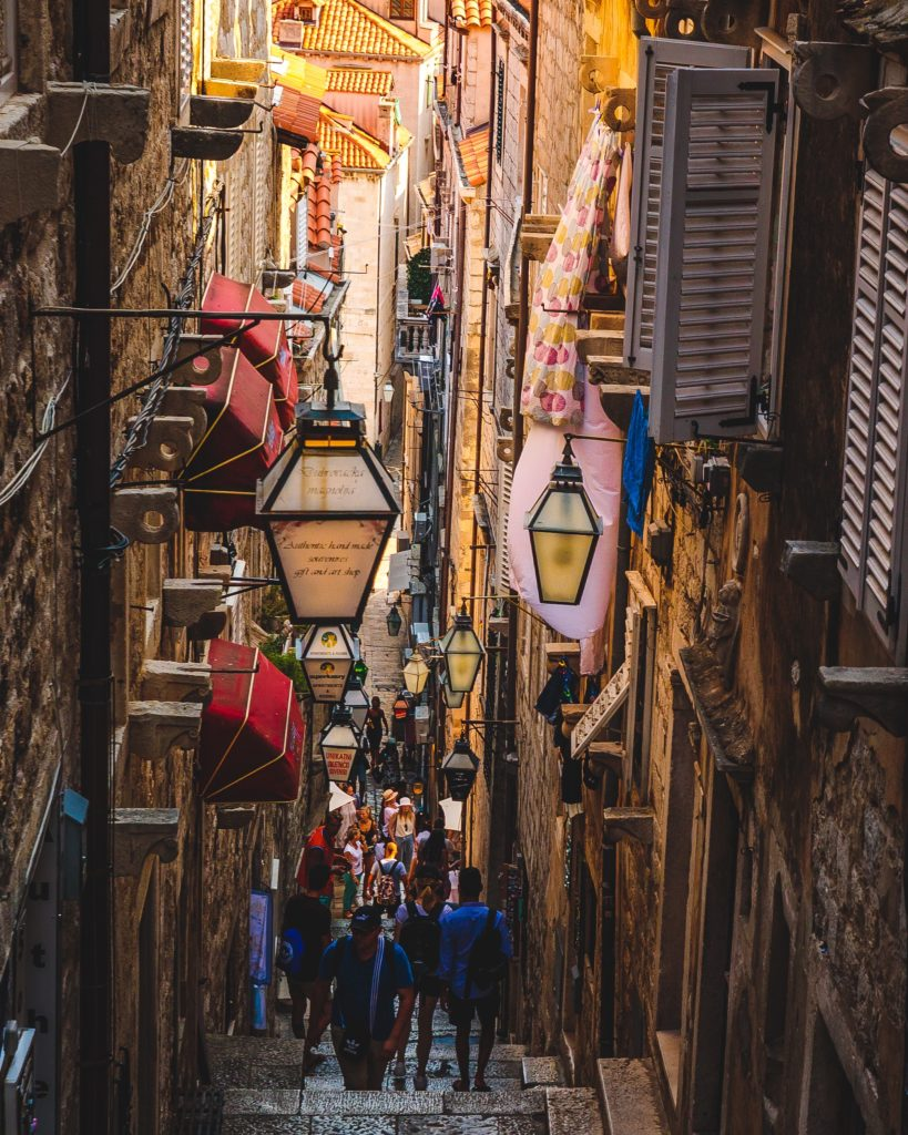 a busy side street in Dubrovnik, shot by earth focus
