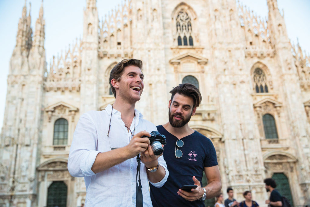 Two men taking a photo of Milan Duomo