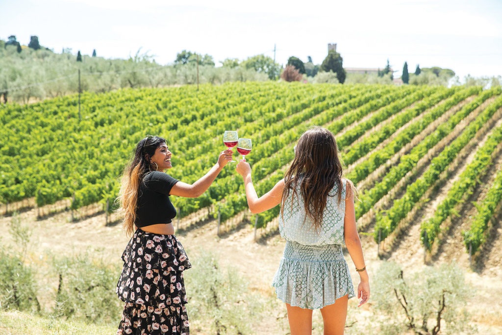 drinking wine in a Tuscan vineyard