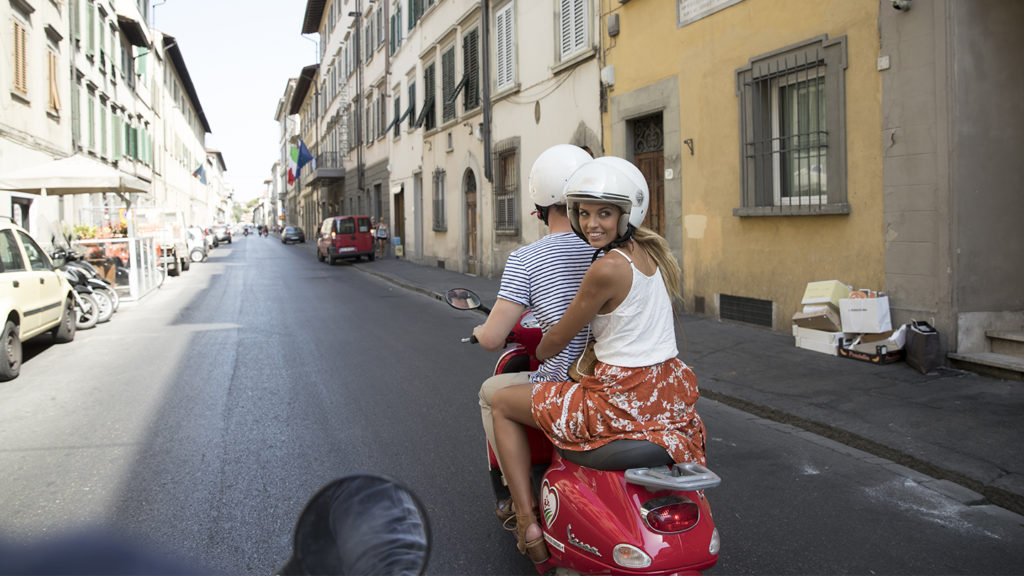 girl riding Vespa in Florence